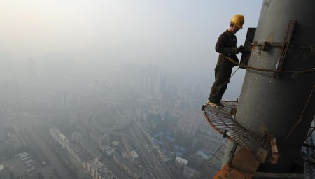 A labourer works on a steel structure at a construction site in Hefei