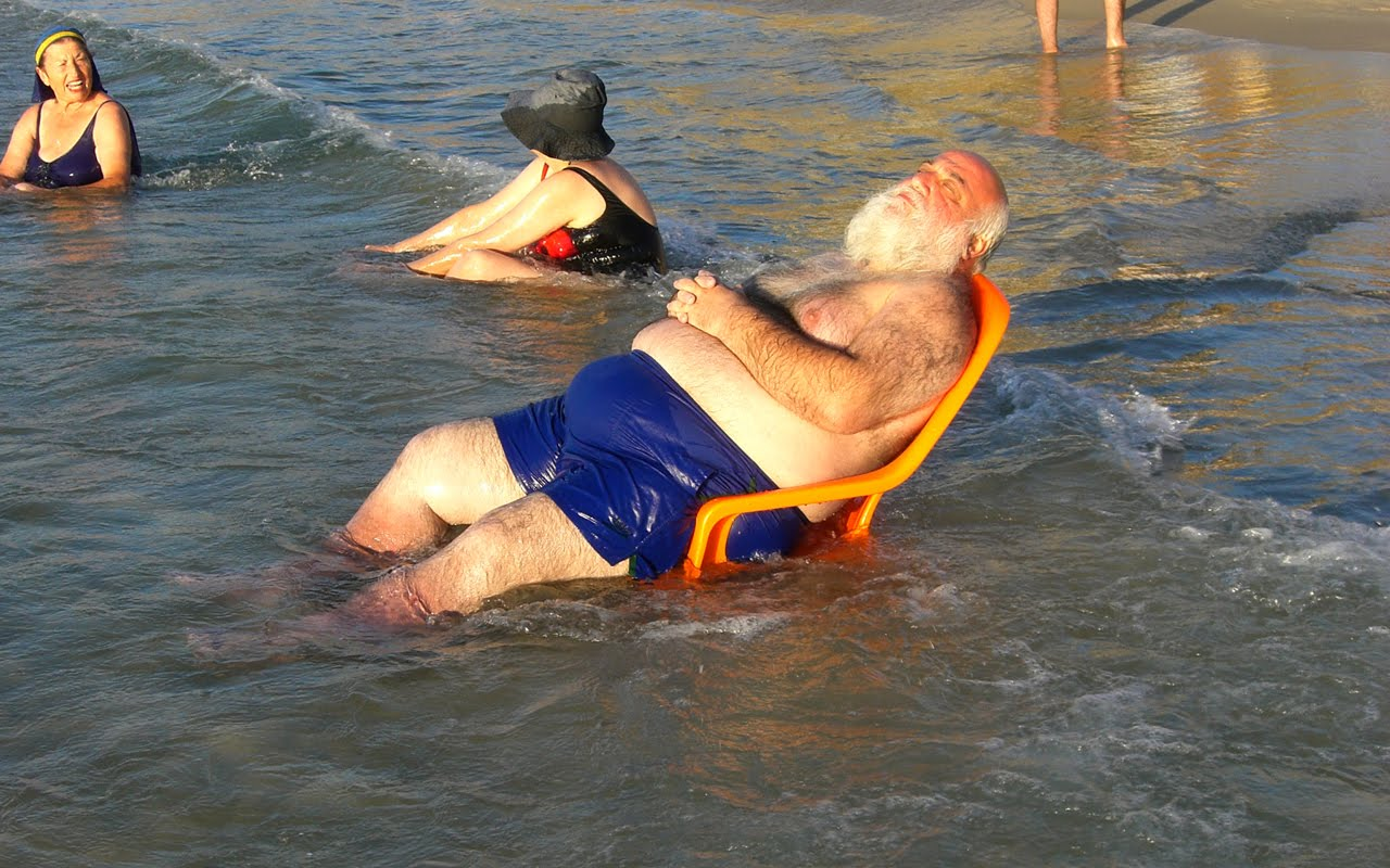 Fat man on beach (1)