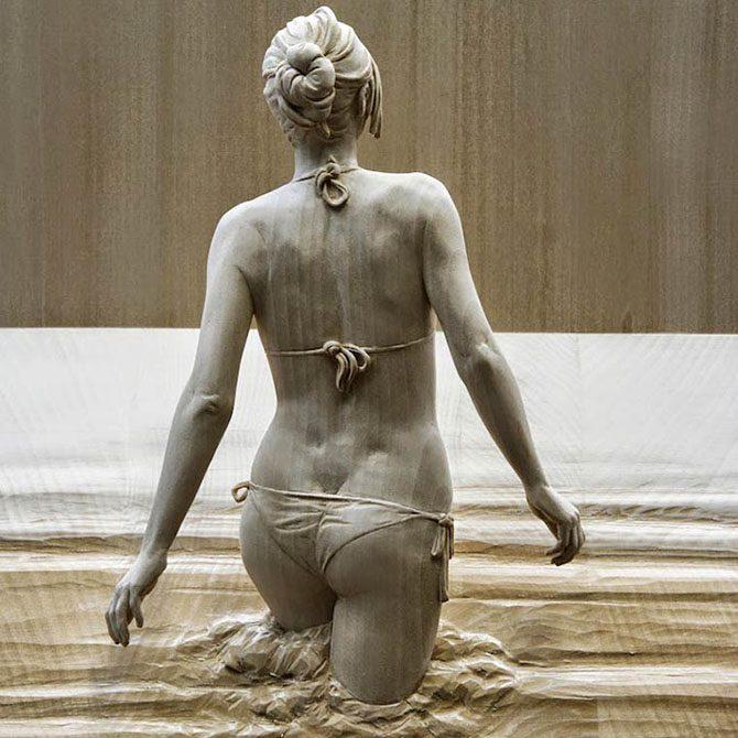 1426443237_prikolnye-skulptury-iz-dereva-1