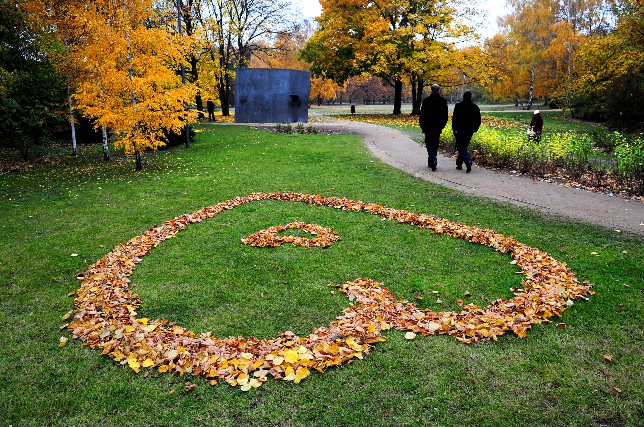 NOVEMBER 2: People walk past a heart made of autumnally colored leaves in Berlin's Tiergarten park. (Johannes Eisele/AFP/Getty Images)