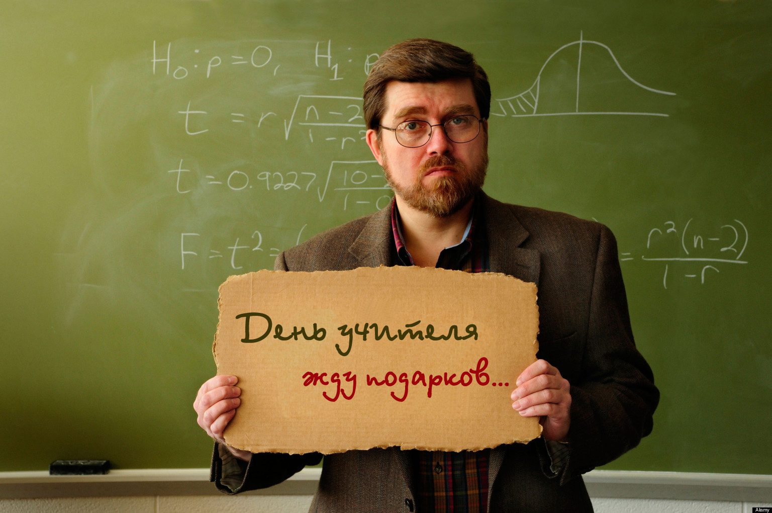 "BPGWBA Professor or teacher in classroom holding a ""Will Work for Food"" sign. Statistical formula on chalkboard in background"
